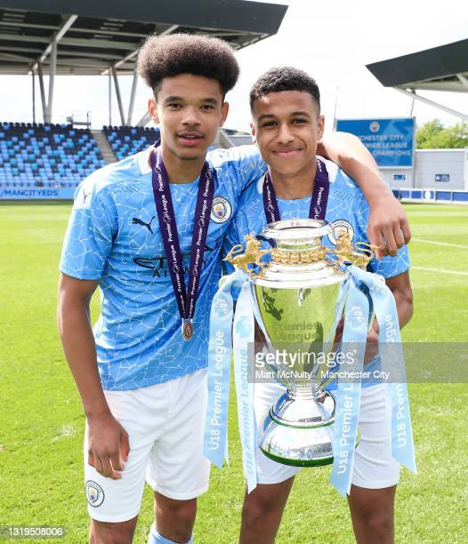 Jadel Katongo and Shea Charles of Manchester City celebrates with the Premier League trophy during the U18 Premier League Final match between...