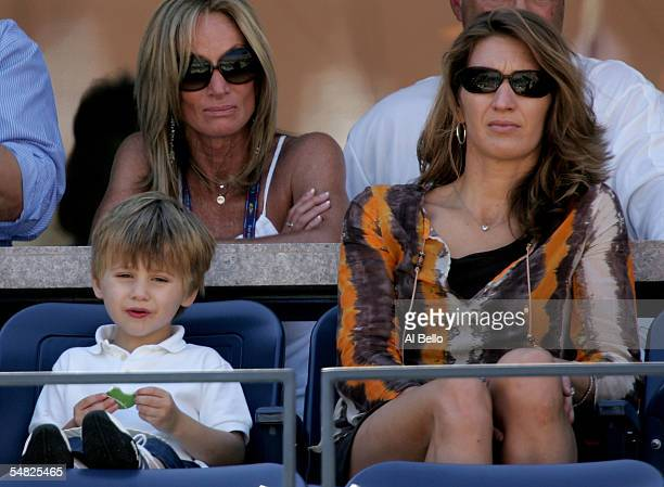 Jaden Agassi and Steffi Graff watch as Andre Agassi takes on Xavier Malisse of Belgium in the fourt round of the US Open at the USTA National Tennis...
