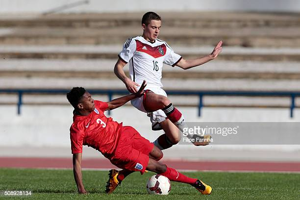 Jaden Brown of England challenges Jan Baxmann of Germany during the UEFA Under17 match between U17 England v U17 Germany on February 7 2016 in Lagos...