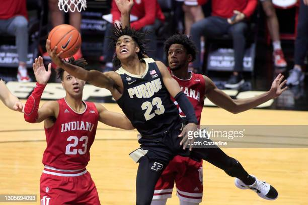 Jaden Ivey of the Purdue Boilermakers drives to the basket while being guarded by Trayce Jackson-Davis and at Mackey Arena on March 06, 2021 in West...