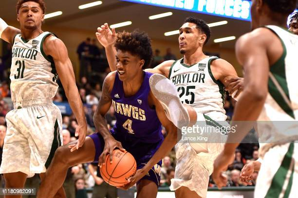 Jaden McDaniels of the Washington Huskies rebounds against Tristan Clark of the Baylor Bears in the second half during the ESPN Armed Forces Classic...