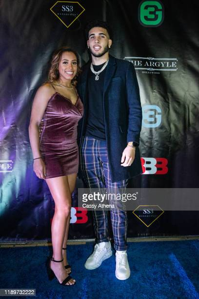 Jaden Owens and boyfriend LiAngelo Ball pose together on the blue carpet at LiAngelo's 21st Birthday Party at Argyle club on November 23, 2019 in...