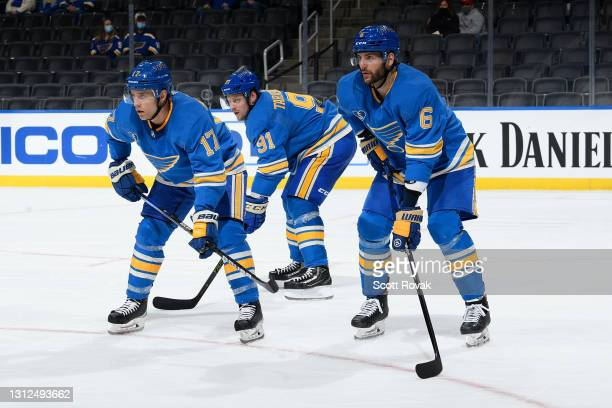 Jaden Schwartz Marco Scandella and Vladimir Tarasenko of the St. Louis Blues look on during a game against the Minnesota Wild on April 10, 2021 at...