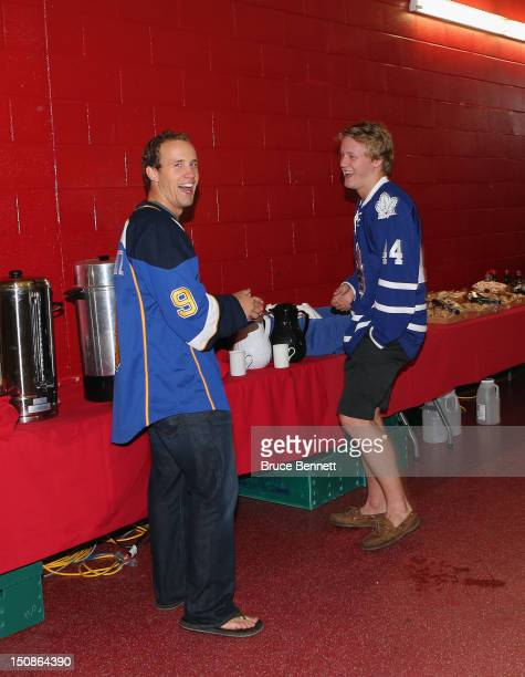 Jaden Schwartz of the St Louis Blues and Morgan Rielly of the Toronto Maple Leafs share a laugh at the 2012 NHLPA rookie showcase at the MasterCard...