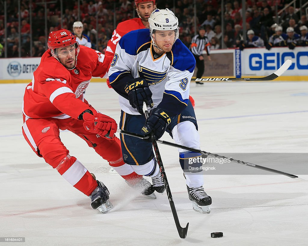 Jaden Schwartz #9 of the St Louis Blues battles for the puck with Drew Miller #20 of the Detroit Red Wingsduring a NHL game at Joe Louis Arena on February 13, 2013 in Detroit, Michigan.
