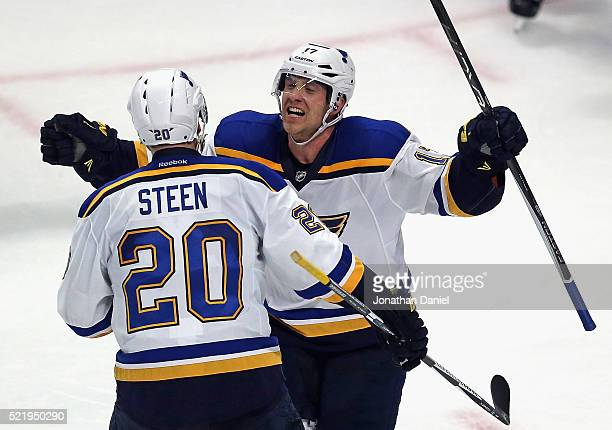 Jaden Schwartz of the St. Louis Blues celebrates his game-winning goal against the Chicago Blackhawks with teammmate Alexander Steen in Game Three of...