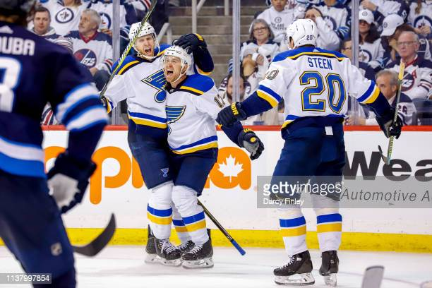 Jaden Schwartz of the St Louis Blues celebrates his third period goal against the Winnipeg Jets with teammates Carl Gunnarsson and Alexander Steen in...