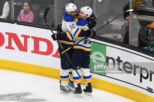 Jaden Schwartz of the St Louis Blues celebrates with Brayden Schenn after his second goal against the San Jose Sharks in Game Five of the Western...