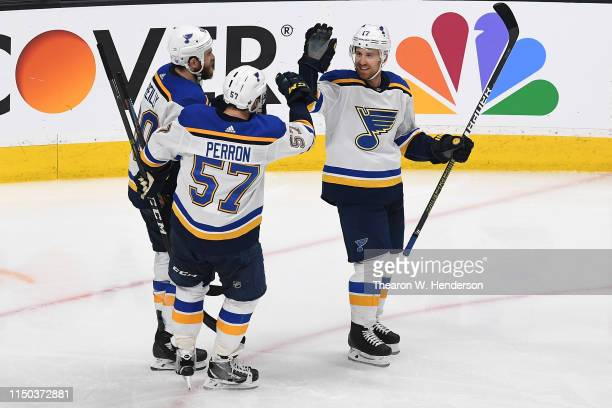 Jaden Schwartz of the St Louis Blues celebrates with Ryan O'Reilly and David Perron after his second goal against the San Jose Sharks in Game Five of...