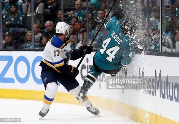 Jaden Schwartz of the St Louis Blues checks MarcEdouard Vlasic of the San Jose Sharks in Game Two of the Western Conference Final during the 2019 NHL...