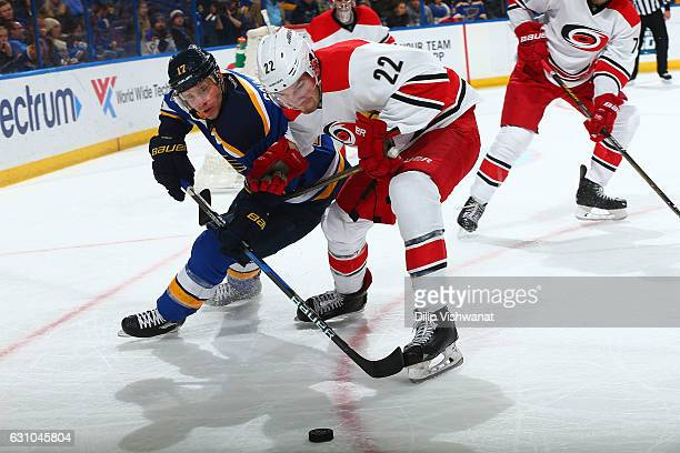 Jaden Schwartz of the St Louis Blues fights Brett Pesce of the Carolina Hurricanes for control of the puck at the Scottrade Center on January 5 2017...