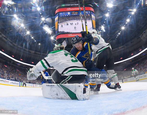 Jaden Schwartz of the St. Louis Blues gets looks for the puck against the Dallas Stars in Game Five of the Western Conference Second Round during the...