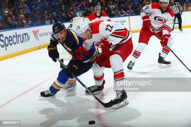 Jaden Schwartz of the St Louis Blues in action against Brett Pesce of the Carolina Hurricanes at the Scottrade Center on January 5 2017 in St Louis...