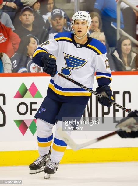 Jaden Schwartz of the St Louis Blues keeps an eye on the play during second period action against the Winnipeg Jets at the Bell MTS Place on October...