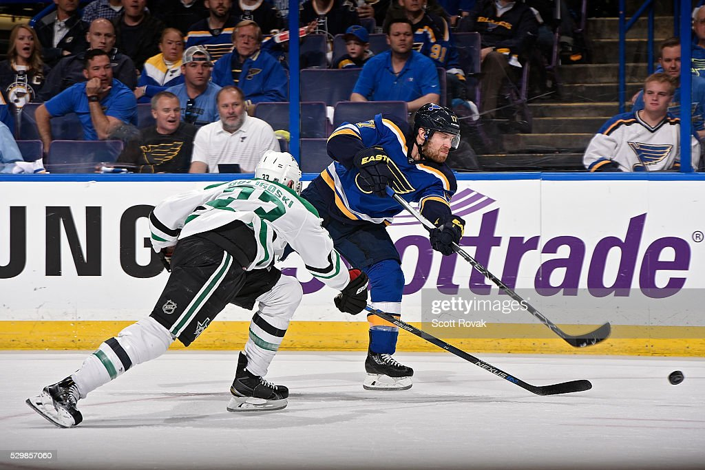 Jaden Schwartz #17 of the St. Louis Blues shoots as Alex Goligoski #33 of the Dallas Stars defends in Game Six of the Western Conference Second Round during the 2016 NHL Stanley Cup Playoffs at the Scottrade Center on May 9, 2016 in St. Louis, Missouri.