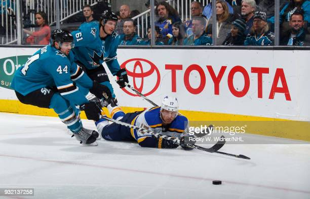 Jaden Schwartz of the St Louis Blues skates after the puck against MarcEdouard Vlasic and Justin Braun of the San Jose Sharks at SAP Center on March...