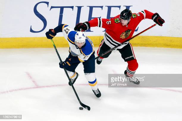 Jaden Schwartz of the St. Louis Blues skates against Connor Murphy of the Chicago Blackhawks during the second period in an exhibition game prior to...