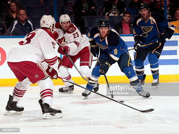 Jaden Schwartz of the St Louis Blues skates against Derek Morris and Oliver EkmanLarsson of the Phoenix Coyotes during an NHL game on January 14 2014...
