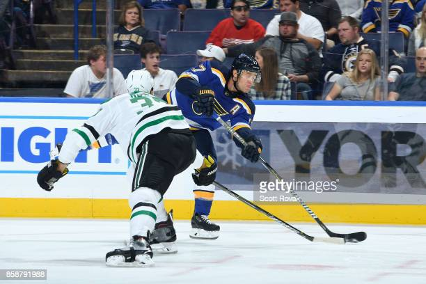 Jaden Schwartz of the St Louis Blues takes a shot as Marc Methot of the Dallas Stars defends on October 7 2017 at Scottrade Center in St Louis...
