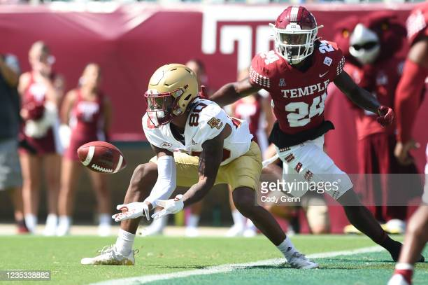 Jaden Williams of the Boston College Eagles catches a touchdown under pressure from Keyshawn Paul of the Temple Owls in the first quarter at Lincoln...