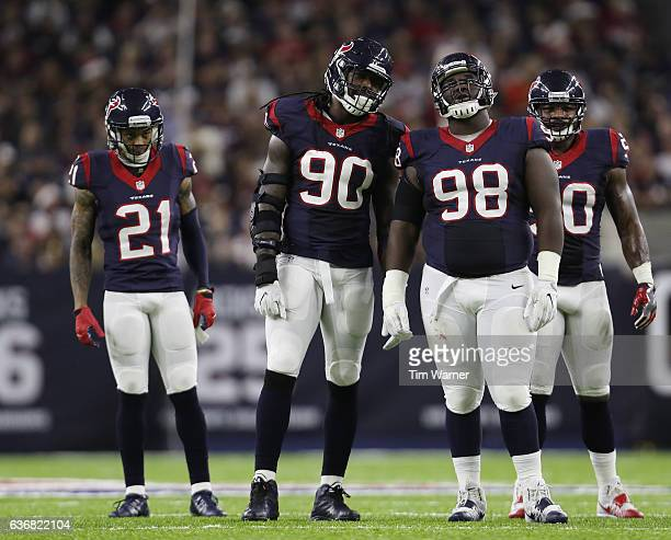 Jadeveon Clowney of the Houston Texans and DJ Reader of the Houston Texans stand at the line of scrimmage before a play in the fourth quarter against...