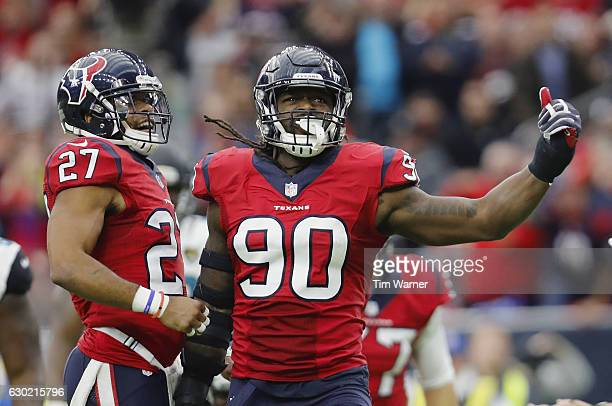 Jadeveon Clowney of the Houston Texans celebrates with Quintin Demps of the Houston Texans after a tackle in the fourth quarter against the...