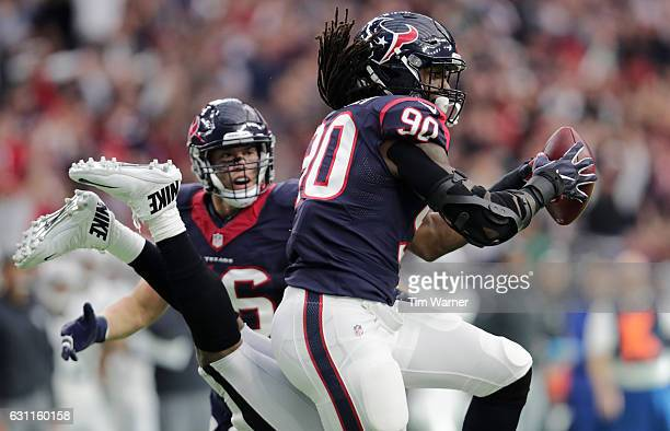 Jadeveon Clowney of the Houston Texans intercepts a pass from Connor Cook of the Oakland Raiders during the first quarter of their AFC Wild Card game...