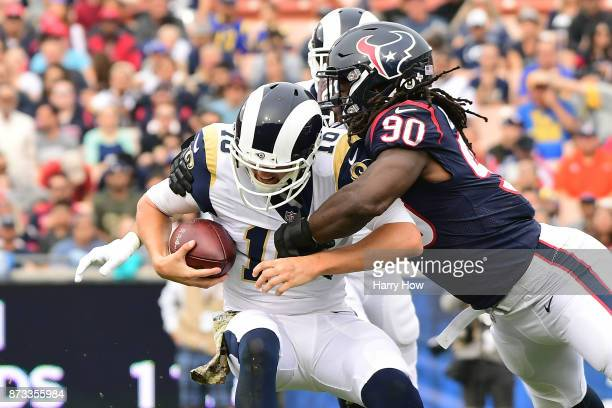 Jadeveon Clowney of the Houston Texans sacks Jared Goff of the Los Angeles Rams during the first half at the Los Angeles Memorial Coliseum on...