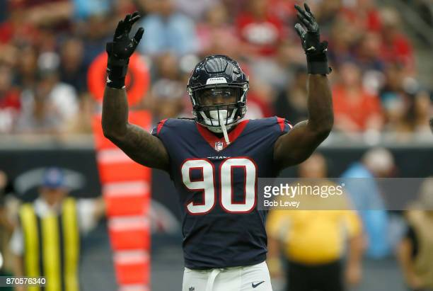 Jadeveon Clowney of the Houston Texans signals for the crowd to get louder against the Indianapolis Colts in the first quarter at NRG Stadium on...