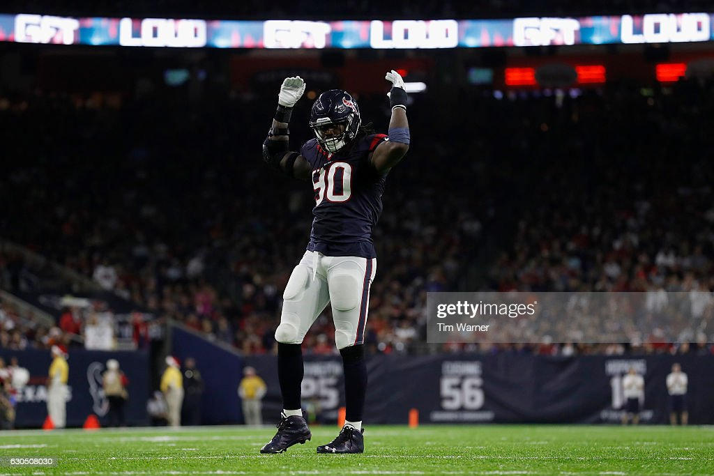 Jadeveon Clowney #90 of the Houston Texans signals the crowd to make noise during the fourth quarter against the Cincinnati Bengals at NRG Stadium on December 24, 2016 in Houston, Texas.