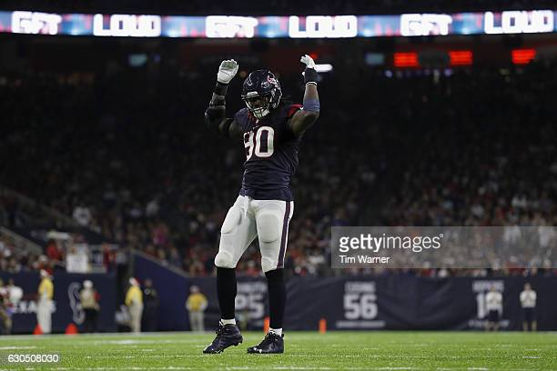 Jadeveon Clowney of the Houston Texans signals the crowd to make noise during the fourth quarter against the Cincinnati Bengals at NRG Stadium on...