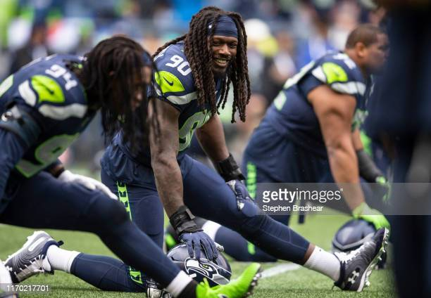 Jadeveon Clowney of the Seattle Seahawks and Ezekiel Ansah stretch before a game against the New Orleans Saints at CenturyLInk Field on September 22,...