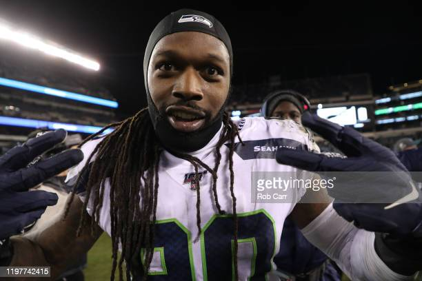 Jadeveon Clowney of the Seattle Seahawks celebrates as he leaves the field after their win over the Philadelphia Eagles during their NFC Wild Card...