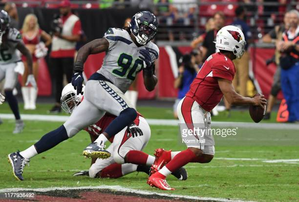 Jadeveon Clowney of the Seattle Seahawks chases Kyler Murray of the Arizona Cardinals out of the pocket during the second half of a game at State...