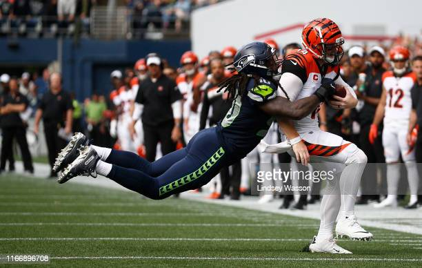 Jadeveon Clowney of the Seattle Seahawks tackles Andy Dalton of the Cincinnati Bengals in the fourth quarter at CenturyLink Field on September 8,...