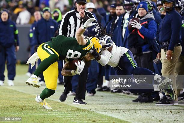 Jadeveon Clowney of the Seattle Seahawks tackles Jace Sternberger of the Green Bay Packers out of bounds during the first half in the NFC Divisional...