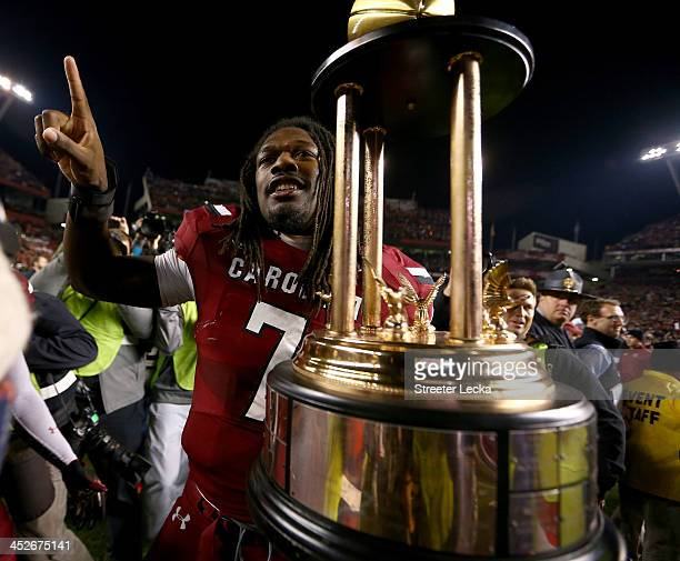 Jadeveon Clowney of the South Carolina Gamecocks celebrates after defeating the Clemson Tigers 3117 after their game at WilliamsBrice Stadium on...