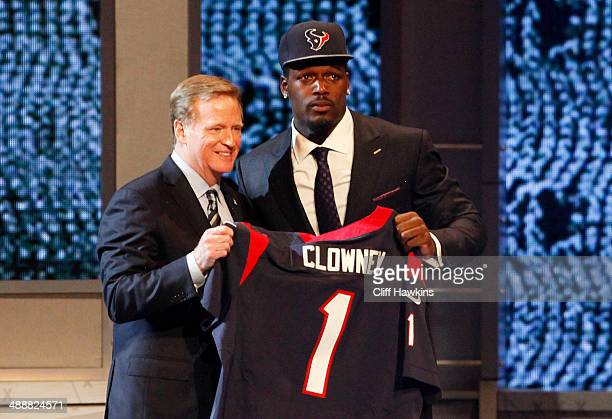 Jadeveon Clowney of the South Carolina Gamecocks stands on stage with NFL Commissioner Roger Goodell after he was picked overall by the Houston...