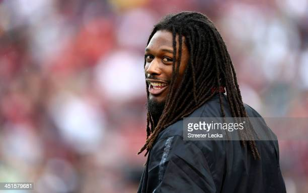 Jadeveon Clowney of the South Carolina Gamecocks watches on from the bench during their game against the Coastal Carolina Chanticleers at...