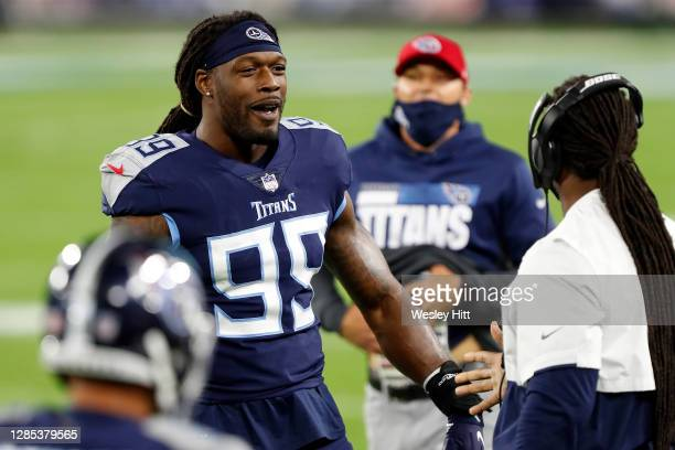 Jadeveon Clowney of the Tennessee Titans speaks with teammates during the first half against the Indianapolis Colts at Nissan Stadium on November 12,...