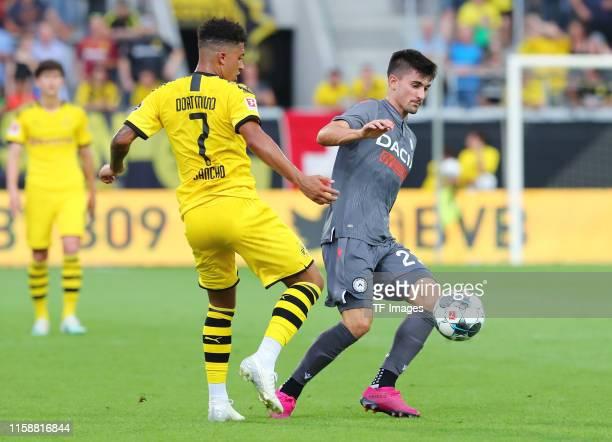 Jadon Malik Sancho of Borussia Dortmund and Ignacio Pussetto of Udinese Calcio battle for the ball during the preseason friendly match between...