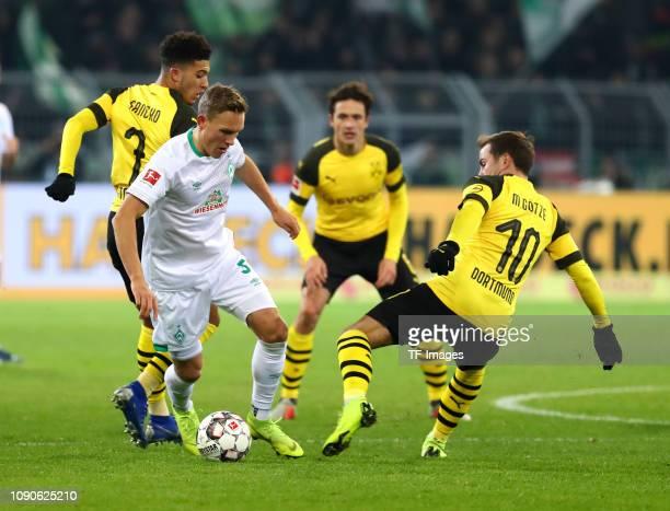 Jadon Malik Sancho of Borussia Dortmund Ludwig Augustinsson of SV Werder Bremen Thomas Delaney of Borussia Dortmund and Mario Goetze of Borussia...