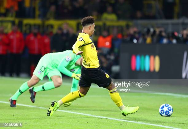 Jadon Malik Sancho of Borussia Dortmund scores the team's third goal against goalkeeper Jan Oblak of Club Atletico de Madrid during the UEFA...