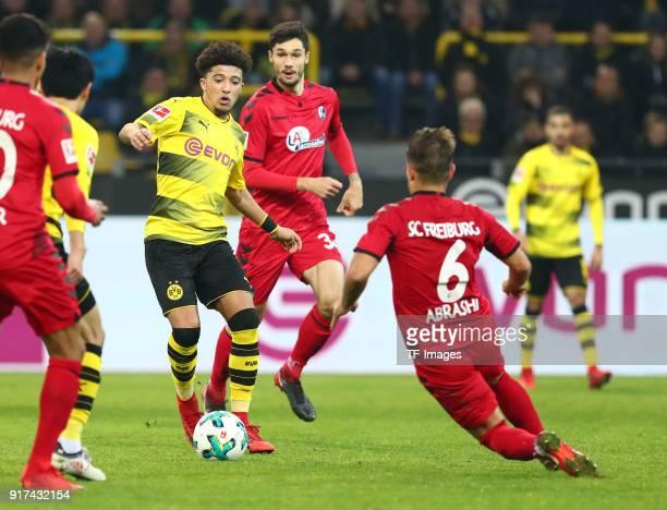 Jadon Malik Sancho of Dortmund and Amir Abrashi of Freiburg battle for the ball during the Bundesliga match between Borussia Dortmund and SportClub...
