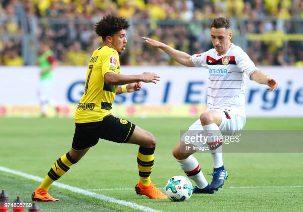 Jadon Malik Sancho of Dortmund and Dominik Kohr of Leverkusen battle for the ball during the Bundesliga match between Borussia Dortmund and Bayer 04...