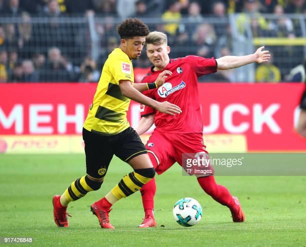 Jadon Malik Sancho of Dortmund and Lukas Kuebler of Freiburg battle for the ball during the Bundesliga match between Borussia Dortmund and SportClub...