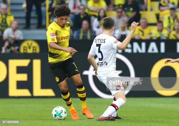 Jadon Malik Sancho of Dortmund and Panagiotis Retsos of Leverkusen battle for the ball during the Bundesliga match between Borussia Dortmund and...