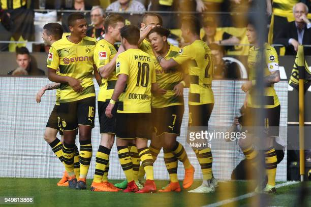 Jadon Malik Sancho of Dortmund is celebrated by his team after he scored a goal to make it 10 during the Bundesliga match between Borussia Dortmund...