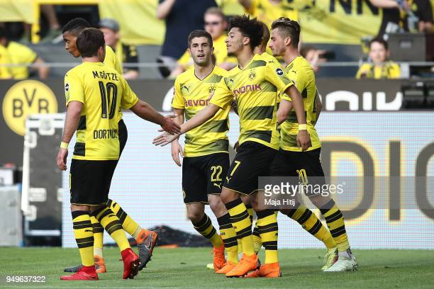 Jadon Malik Sancho of Dortmund is celebrated by his team after he scored a goal to make it 1= during the Bundesliga match between Borussia Dortmund...
