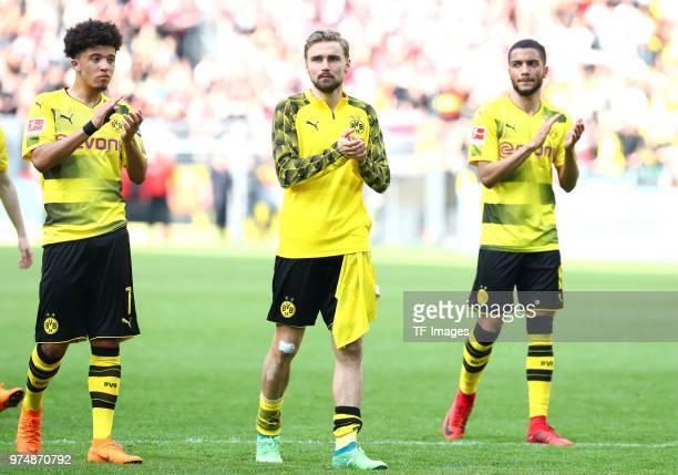 Jadon Malik Sancho of Dortmund Marcel Schmelzer of Dortmund and Jeremy Toljan of Dortmund celebrate after winning the Bundesliga match between...